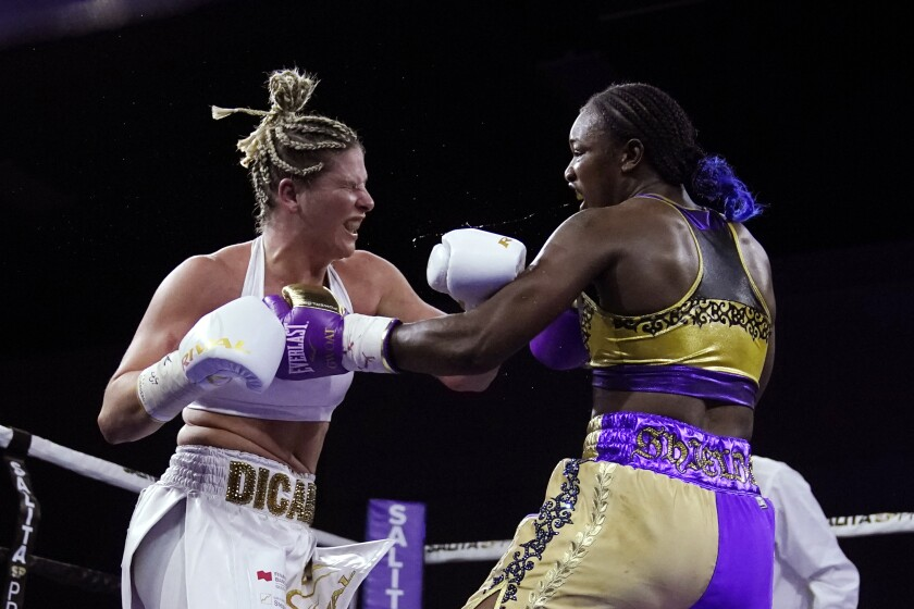 Marie-Eve Dicaire, left, and Claressa Shields face off during the eighth round of a boxing bout for the women's super welterweight title Friday, March 5, 2021, in Flint, Mich. (AP Photo/Carlos Osorio)