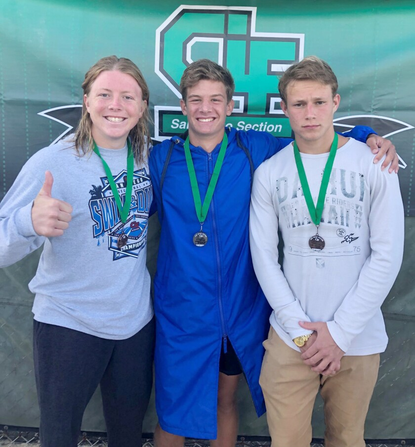 Bulldog divers wearing the medals they earned at the CIF finals May 3 are, from left, senior Frankie Trout, No. 8 medalist; junior Jacob Nelson, No. 2 medalist; and freshman Caden Clark, No. 7 medalist.