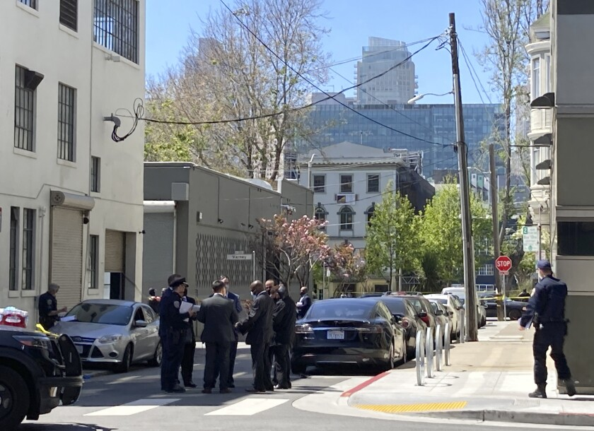 """Authorities investigate the shooting of a burglary suspect in San Francisco on Friday, May 7, 2021. Plainclothes San Francisco police officers shot and injured a known burglary suspect in the city's South of Market neighborhood and two other suspects fled the scene in a vehicle, a police spokesman said Friday. The man was not seriously injured. San Francisco Police Department spokesman Officer Robert Rueca said the officers """"had information of a known auto burglary suspect and they were conducting an investigation into that vehicle and the occupants in that vehicle."""" (AP Photo/Juliet Williams)"""