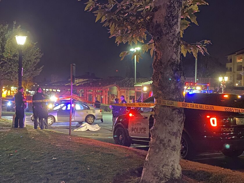 La Mesa police investigate shooting death of man Friday night at shopping center off Lake Murray Boulevard near Aztec Drive.