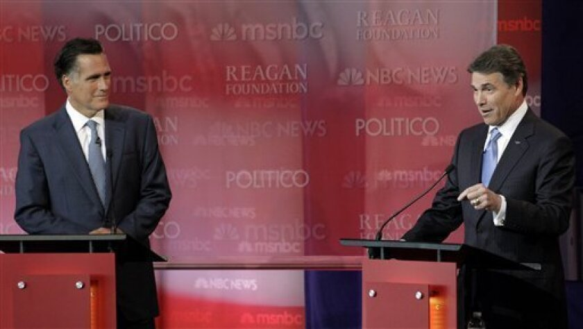 Republican presidential candidate Texas Gov. Rick Perry answers a question as Republican presidential candidate former Massachusetts Gov. Mitt Romney listens during a Republican presidential candidate debate at the Reagan Library Wednesday, Sept. 7, 2011, in Simi Valley, Calif. (AP Photo/Jae C. Hong)