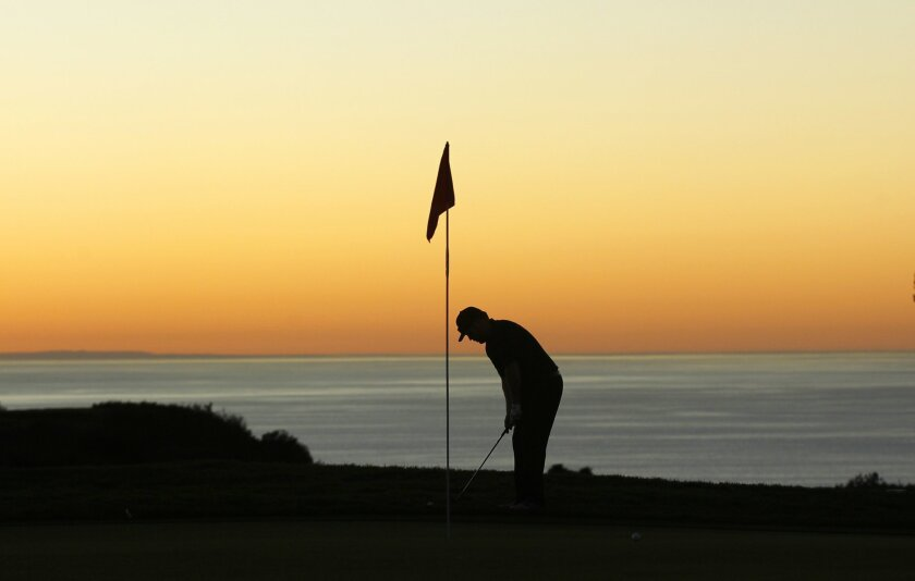 Jesse Tarr putts on the 9th hole of Torrey Pines North Course.  The course will be closed to the public for several months for a renovation.