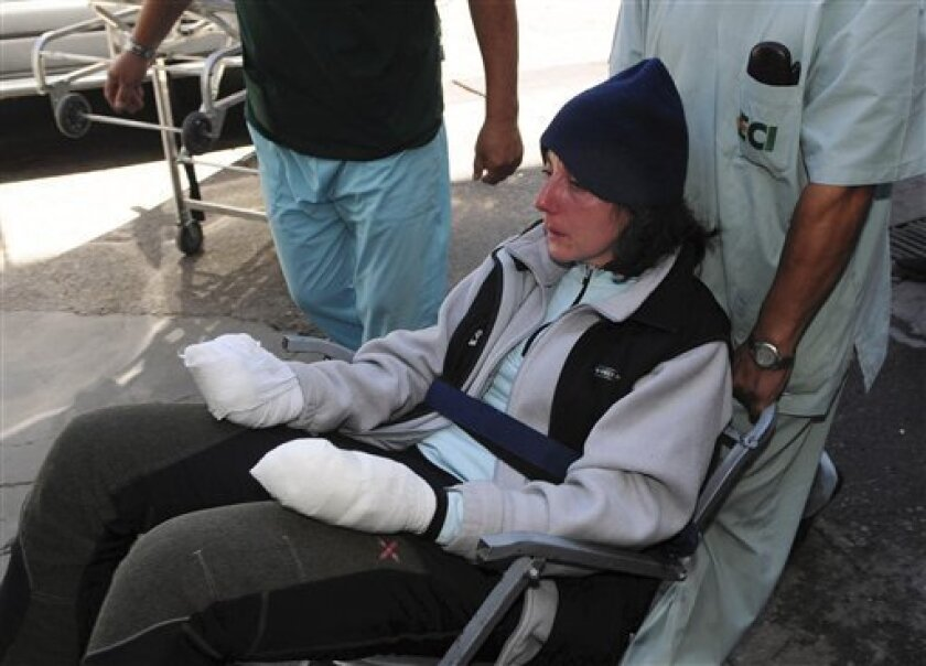 Italian climber Marina Acanazio, 38, arrives to a hospital in Mendoza, Argentina, after being saved by the largest-ever rescue effort on Mount Aconcagua, the highest mountain in the Americas, Friday, Jan. 9, 2009. She was rescued along with fellow climbers Italian Marco Afasio, 39, while Italian Ma