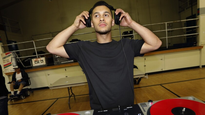 DJ Lean Rock provides the music for a public session at Salazar Park Community Center the night before the competition.