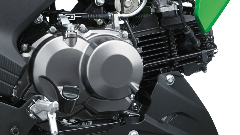 The 125cc single cylinder twin valve engine pumps its approximate 10 horsepower through a four-speed