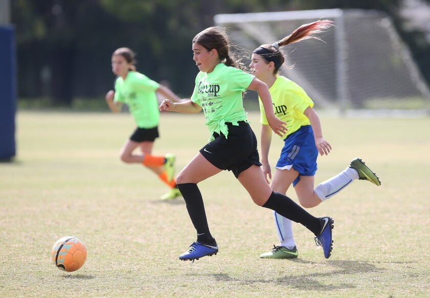 Huntington Beach Pegasus player Talia Ghorban dribbles up field coast-to-coast in a girls' fifth-