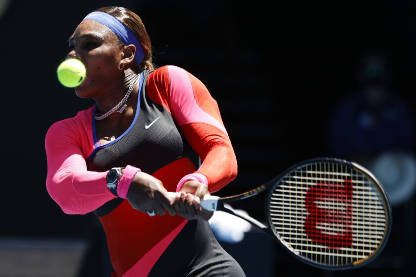 United States' Serena Williams makes a backhand return to Serbia's Nina Stojanovic during their second round match at the Australian Open tennis championship in Melbourne, Australia, Wednesday, Feb. 10, 2021.(AP Photo/Rick Rycroft)