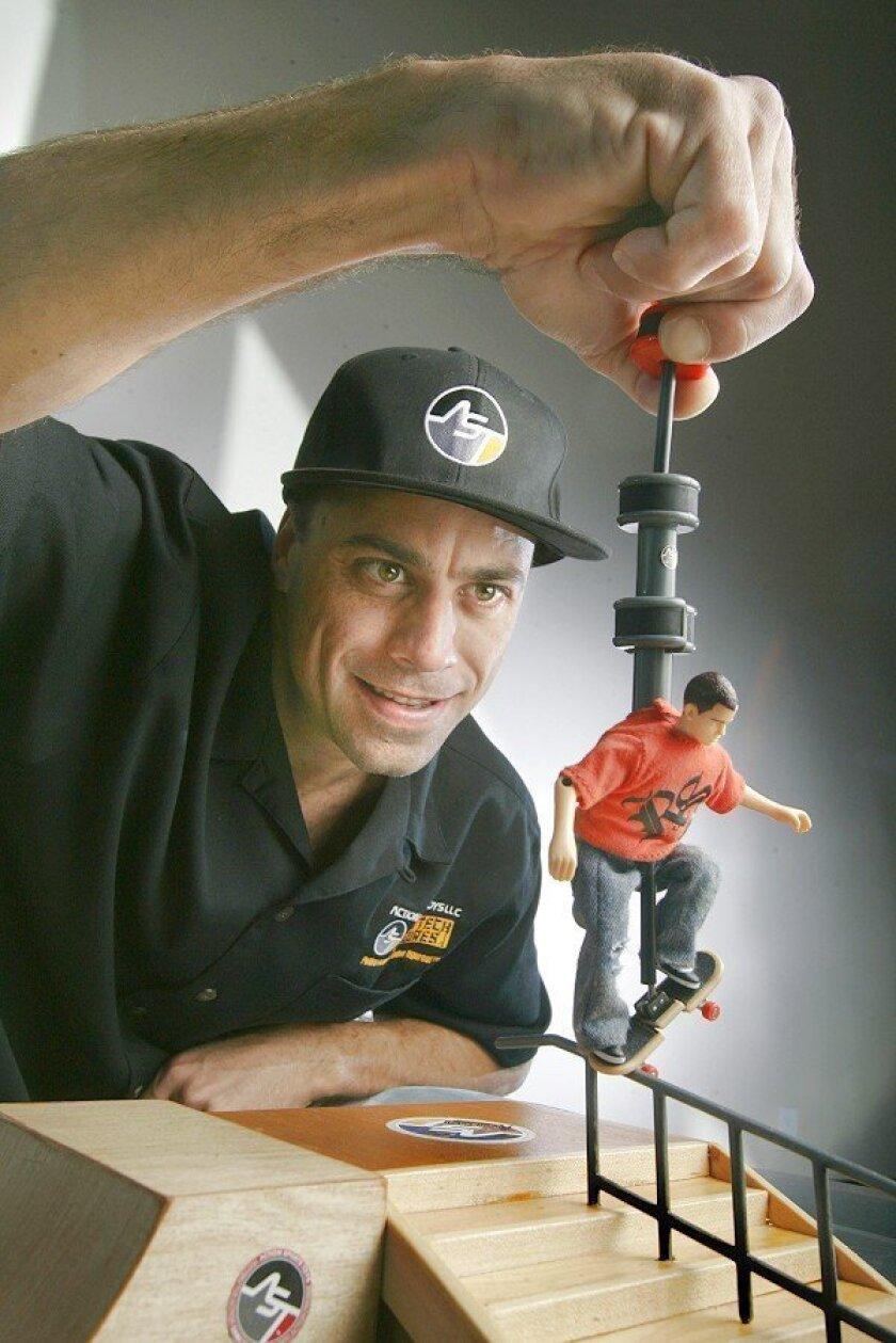 Michael Bellon demonstrates the Ryan Sheckler Omnitech Handle skateboarding action figure he developed. Bellon's line will include two more skateboarders.