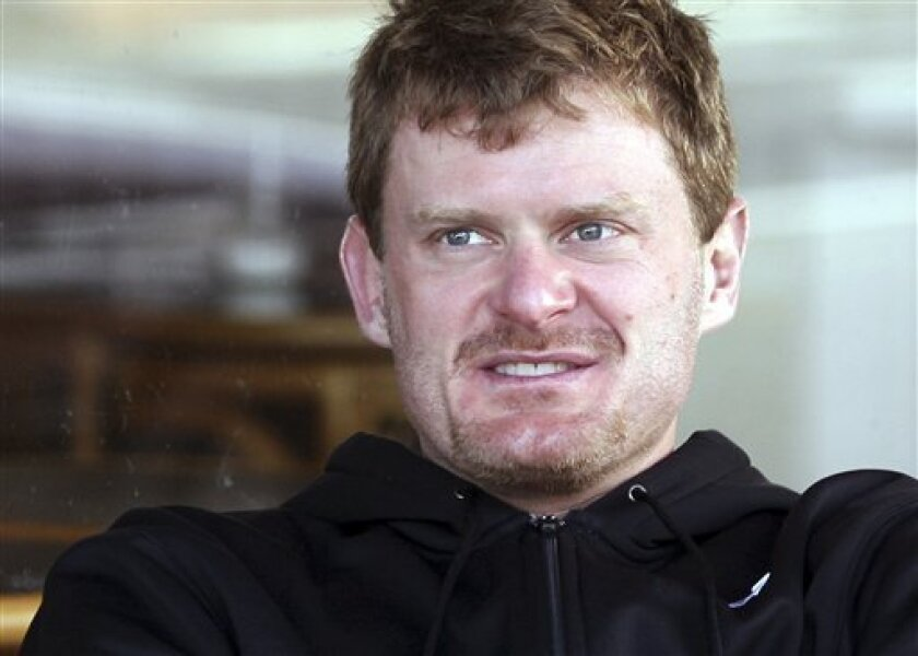 FILE - This Nov. 7, 2009, file photo shows Floyd Landis during a rest day of the PowerNet Cycle Tour in Southland, Winton, New Zealand. Cycling's governing body warned Landis he could be sued for defamation weeks before he made allegations that it covered up a positive drug test by Lance Armstrong. Former UCI president Hein Verbruggen told The Associated Press on Tuesday, June 8, 2010, that a letter was sent to Landis two or three weeks before his allegations became public. (AP Photo/NZPA, Dianne Manson)