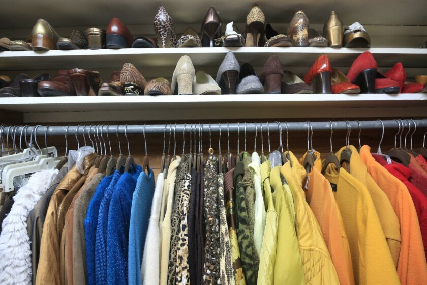 Professional organizer Colete Michelle has arranged her clothing and shoes by color to simplify coordinating outfit combinations. SHoes are also stored toe to heel to maximize space.