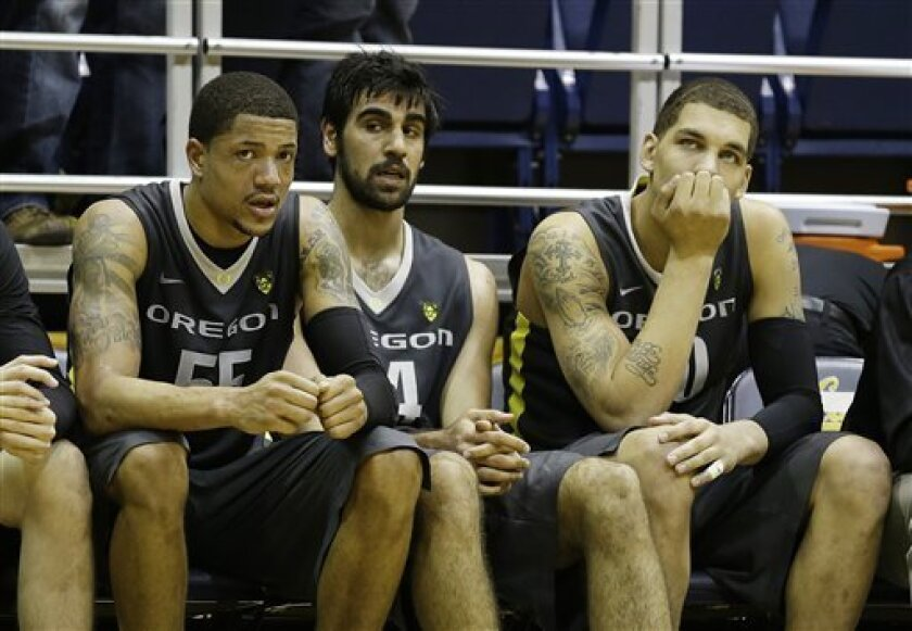 Oregon players, from left, Tony Woods, Arsalan Kazemi and Waverly Austin sit on the bench in the final moments of their NCAA college basketball game against California Saturday, Feb. 2, 2013, in Berkeley, Calif. California won the game 58-54. (AP Photo/Eric Risberg)