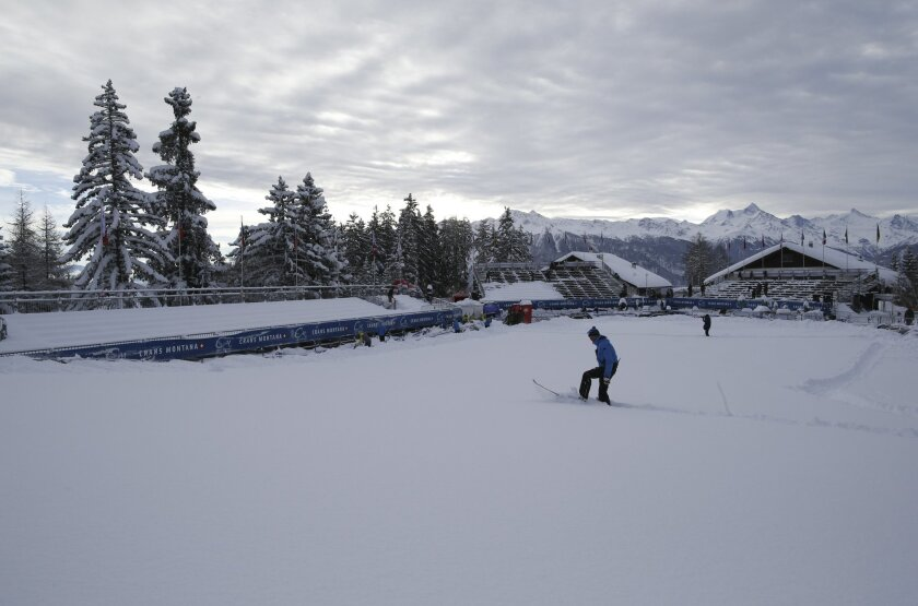 A view of the finish area after an alpine ski, women's World Cup downhill race was canceled, following a heavy snowfall, in Crans Montana, Switzerland, Saturday, Feb. 13, 20176. (AP Photo/Alessandro Trovati)
