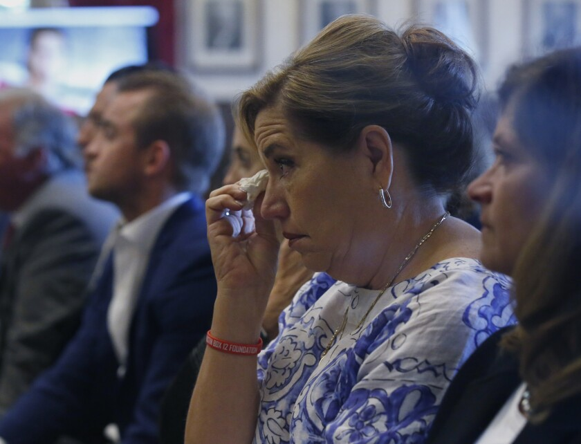 Gail Box listens during closing arguments in Oklahoma's opioid lawsuit against Johnson & Johnson. Her son, former University of Oklahoma football player Austin Box, died of a drug overdose in 2011.