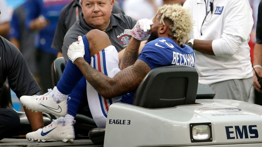 New York Giants wide receiver Odell Beckham is taken off the field on a cart after a season-ending injury suffered in Week 5.