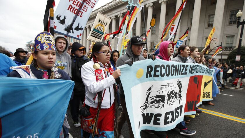 Native Americans and their supporters march toward the White House on March 10, 2017, in protest of the Dakota Access oil pipeline.