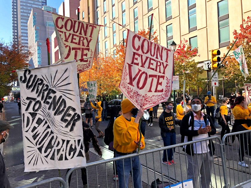 Protesters in Philadelphia denounced Donald Trump's effort to limit the counting of votes.