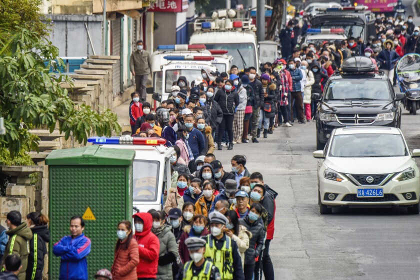 People line up to buy face masks Jan. 29 in Nanning, China.