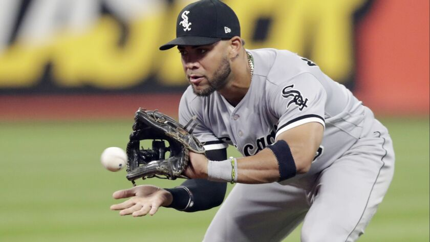 In this Sept. 19, 2018, file photo, Chicago White Sox's Yoan Moncada fields a ball hit by Cleveland Indians' Melky Cabrera during the fourth inning of a baseball game in Cleveland. Cabrera was out on the play.