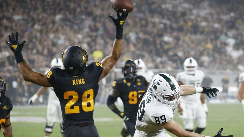 Arizona State defensive back Demonte King (28) tips a pass intended for Michigan State tight end Mat
