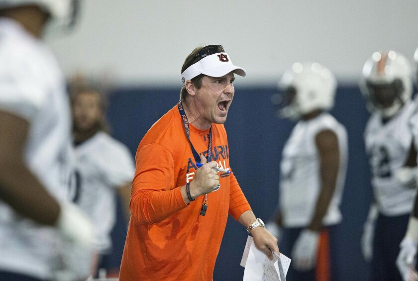 FILE - In this Aug. 4, 2015, file photo, Auburn's defensive coordinator Will Muschamp screams at a player during an NCAA college football practice in Auburn, Ala. The Auburn Tigers are hoping for a swift defensive turnaround under coordinator Will Muschamp after some mediocre, and some downright porous, performances in recent seasons. (AP Photo/Brynn Anderson, File)