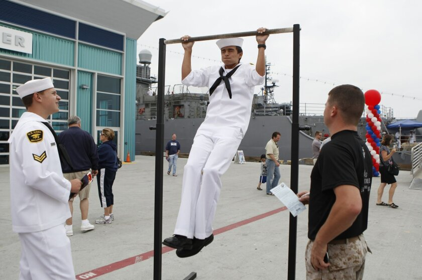 Sea Cadet Sean Depolo attempted a final pull-up during the Fleet Week Big Bay Family Festival at Broadway pier in downtown San Diego. The free event continues today from 10 a.m. to 4 p.m.; weapons, vehicles and boats are on display.