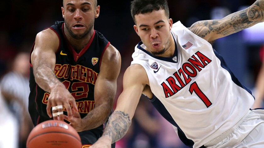 Arizona guard Gabe York steals the ball from USC guard Julian Jacobs during the first half of their game Sunday.