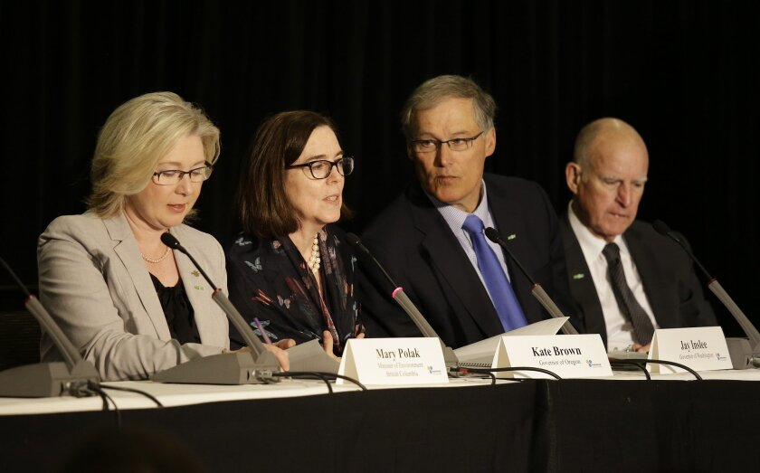 From left, Mary Polak, Minister of Environment of British Columbia, Canada, Oregon Gov. Kate Brown, Washington Gov. Jay Inslee and California Gov. Jerry Brown take part in a roundtable discussion during the Subnational Clean Energy Ministerial Wednesday, June 1, 2016, in San Francisco. (AP Photo/Er