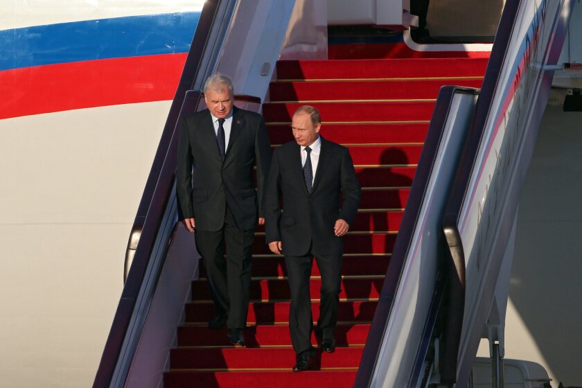 Russian President Vladimir Putin arrives at Beijing Capital International Airport on Sept. 2 to attend China's massive military parade.