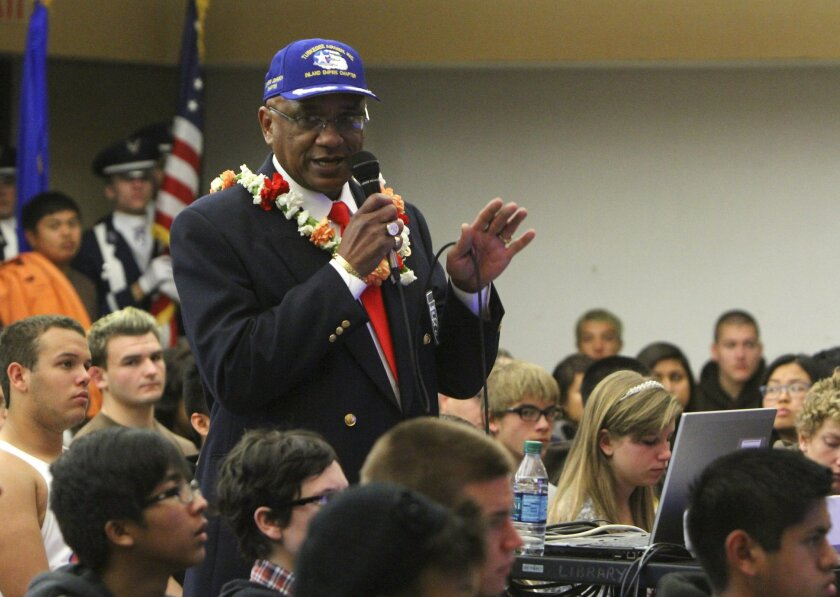 Robert Lee Porter shows students a slideshow about the Tuskegee Airmen an assembly at Temecula Valley High School on Wednesday.