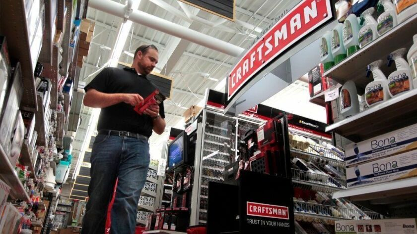 Jake Govorchin, of Chicago, passes by a Craftsman tool display at Gordon's Ace Hardware on Chicago's North Side on Aug. 30, 2011. Both Sears and Stanley Black & Decker will be making and selling Craftsman-branded products.