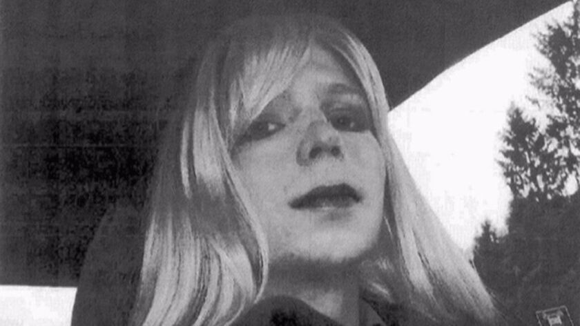 FILE - This undated file photo provided by the U.S. Army shows Pfc. Chelsea Manning wearing a wig an