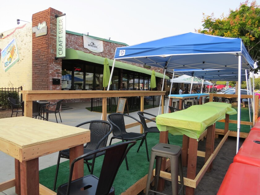 A new covered outdoor dining deck at Brewed Vista on Main Street in Vista