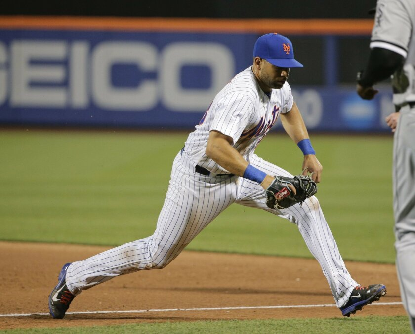 New York Mets first baseman James Loney chases down a hard hit ball by Chicago White Sox's Jose Abreu during the sixth inning of a baseball game, Tuesday, May 31, 2016, in New York. (AP Photo/Julie Jacobson)