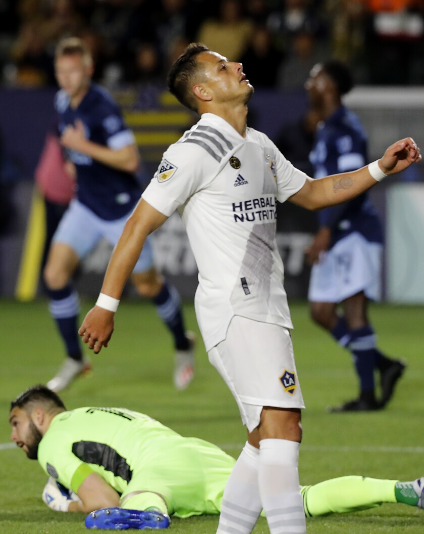 """Javier """"Chicharito"""" Hernandez reacts after Vancouver goalie Maxime Crepeau makes a save during the first half of a game on March 7, 2020, at Dignity Health Sports Park."""
