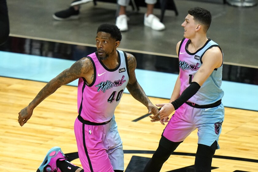 FILE - In this Thursday, May 13, 2021, file photo, Miami Heat forward Udonis Haslem (40) is congratulated by guard Tyler Herro, right, after scoring during the first half of the team's NBA basketball game against the Philadelphia 76ers, in Miami. Miami Heat captain Haslem, the NBA's oldest current player at 41, returned to practice with his team for the first time this season Sunday, Oct. 10, 2021, after missing the first two weeks of camp to grieve the death of his father. (AP Photo/Lynne Sladky, File)