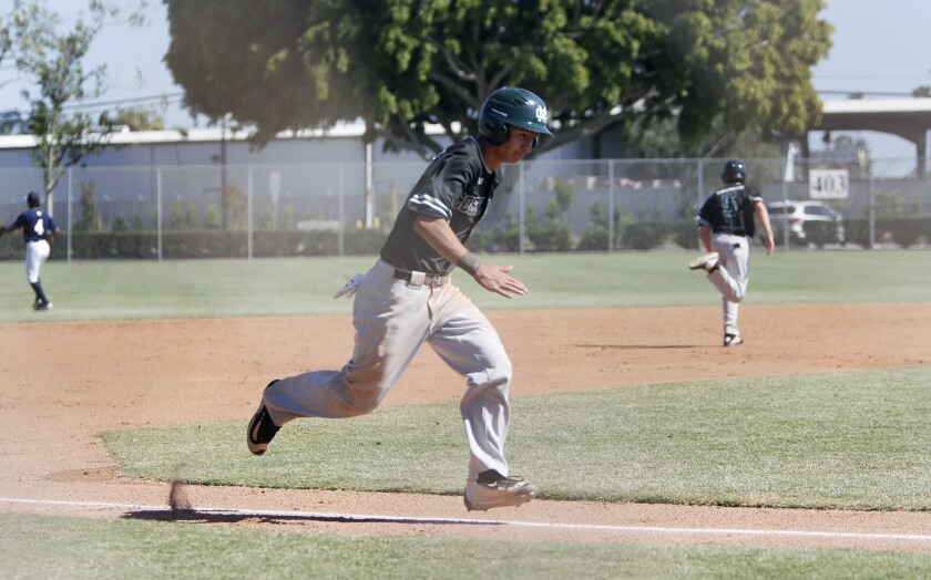 Costa Mesa High's Miguel Rodriguez sprints home for a run against Calvary Chapel during the first in