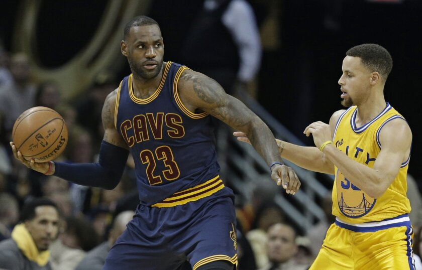 Cleveland Cavaliers' LeBron James, left, drives past Golden State Warriors' Stephen Curry in the second half of an NBA basketball game, Monday, Jan. 18, 2016, in Cleveland. The Warriors won 132-98. (AP Photo/Tony Dejak)