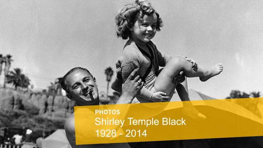 Shirley Temple is shown with her father, George F. Temple, as they enjoy a day at the beach at the Santa Monica Athletic Club in Santa Monica.