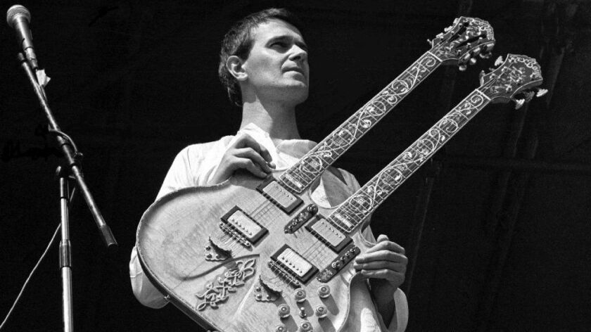 John McLaughlin, shown performing in 1974 with the Mahavishnu Orchestra at the Knebworth Festival in England, is on his farewell American tour, including shows Friday and Saturday at the Vic in Chicago.