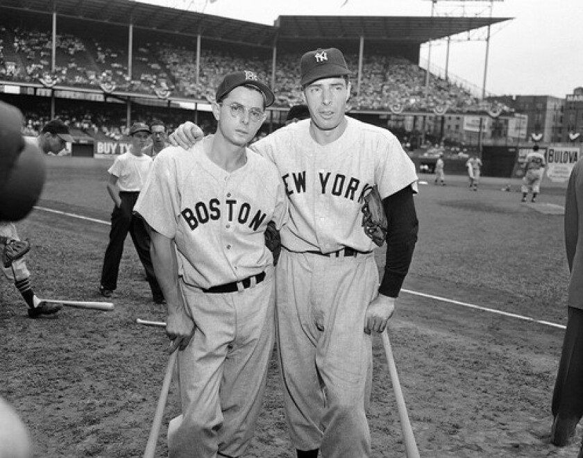 Joe DiMaggio, right, with his brother Dominic in 1949.