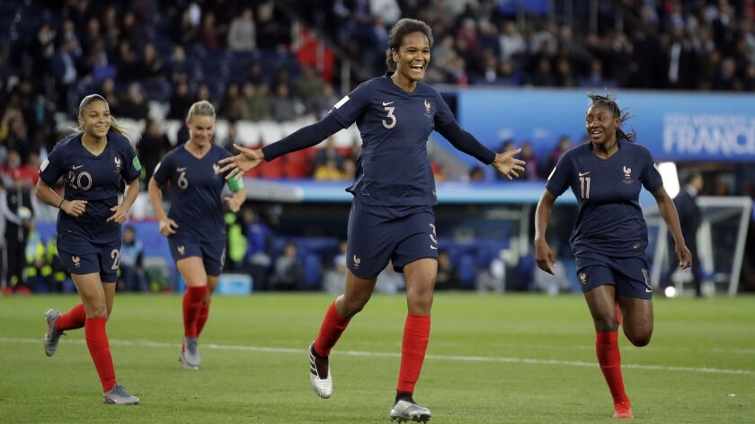 France's Wendie Renard, middle, celebrates with teammates after scoring her second goal during the W