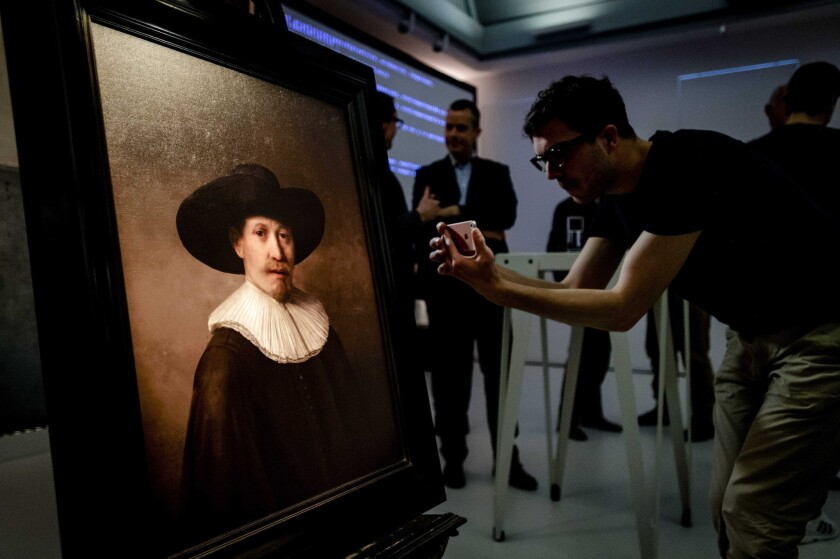 """A new """"Rembrandt"""" painting, created by scientists and technicians based on digital analysis of the artist's known body of work, is unveiled Tuesday in Amsterdam."""