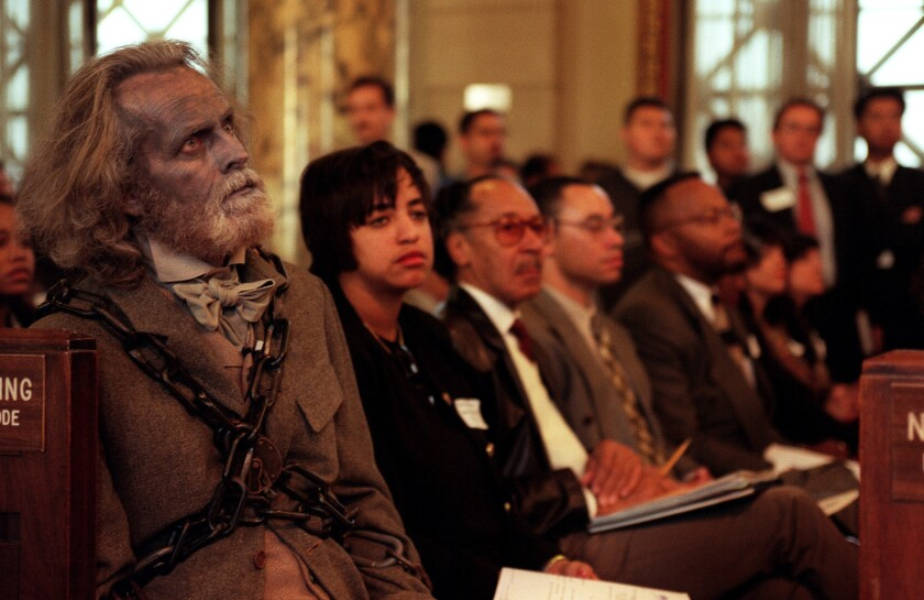 """Actor David Clennon, dressed as the Ghost of Jacob Marley, left, waits to warn Mayor Richard Riordan to stop opposing the pending living wage ordinance in December 1996. Clennon, an Academy of Motion Picture Arts & Sciences member, is now taking action against """"Zero Dark Thirty."""""""