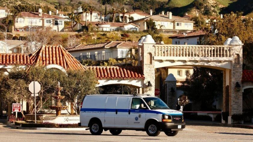 A coroner's van leaves the Renaissance gated community, where Los Angeles police are investigating a triple homicide.