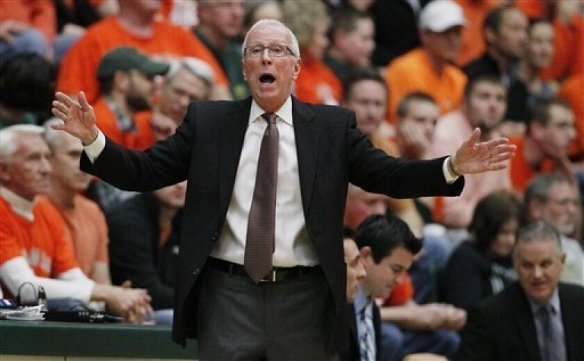 San Diego State head coach Steve Fisher directs his team against Colorado State in the first half of an NCAA college basketball game in Fort Collins, Colo., Wednesday, Feb. 13, 2013. (AP Photo/David Zalubowski)