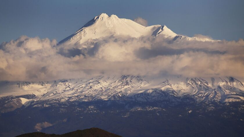 CRESCENT CITY, CA - APRIL 26, 2017- The top of Mount Shasta, peeks above the clouds on April 26, 201