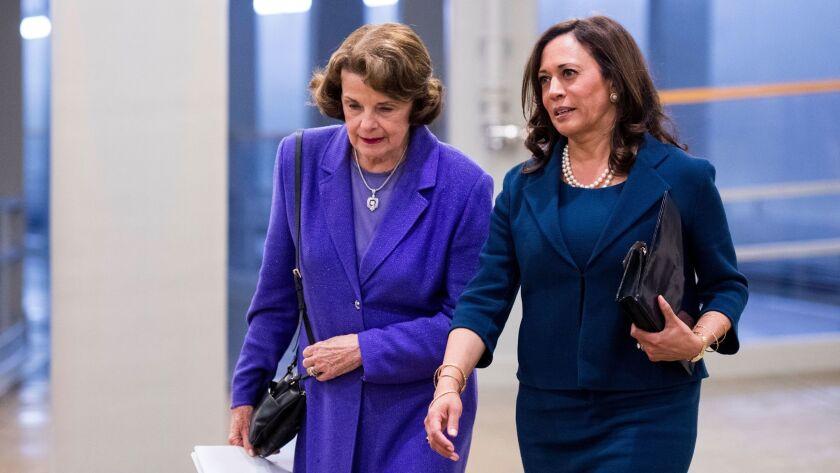 Sen. Dianne Feinstein (D-Calif.), left, and Sen. Kamala Harris (D-Calif.) arrive in the Capitol for a vote on Sept. 7.