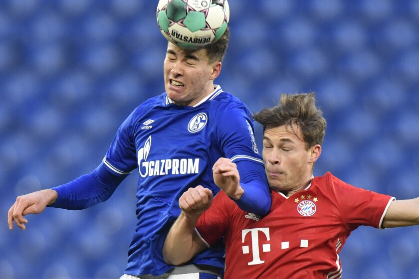 Bayern's Joshua Kimmich, right, and FC Schalke's Matthew Hoppe battle for the ball during a match on Jan. 24.
