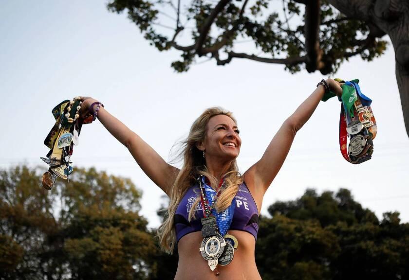 Marathon runner Julie Weiss displays her medals.