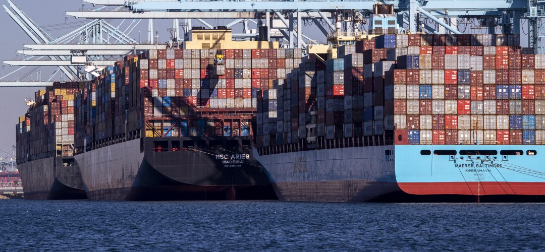 Thousands of containers are unloaded from a ship at the Ports of Los Angeles and Long Beach.